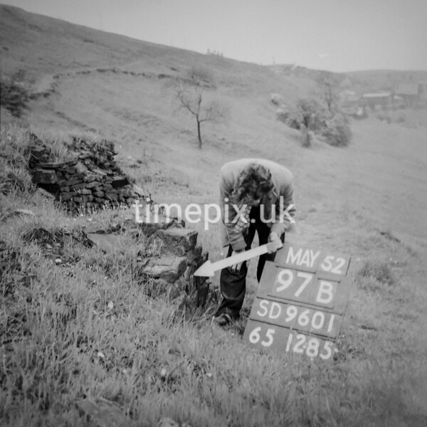 SD960197B, Man marking Ordnance Survey minor control revision point with an arrow in 1950s
