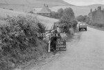 SD980232K, Man marking Ordnance Survey minor control revision point with an arrow in 1950s