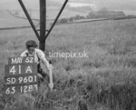 SD960141A, Man marking Ordnance Survey minor control revision point with an arrow in 1950s