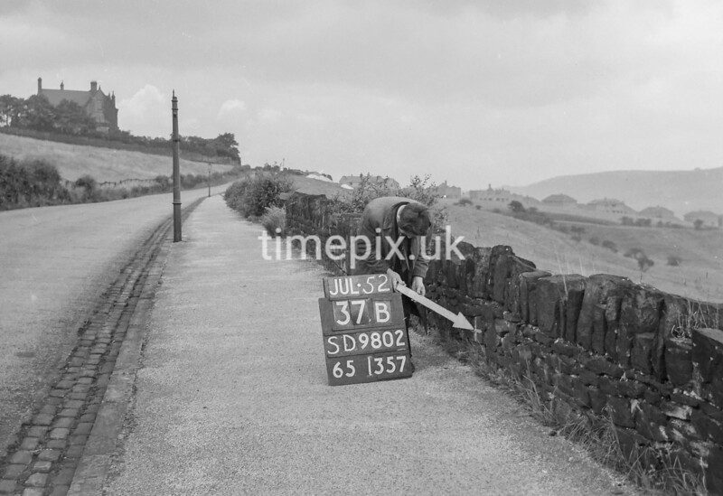 SD980237B, Man marking Ordnance Survey minor control revision point with an arrow in 1950s