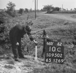 SD950210C, Man marking Ordnance Survey minor control revision point with an arrow in 1950s