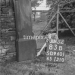 SD960183B, Man marking Ordnance Survey minor control revision point with an arrow in 1950s