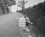 SD960183A, Man marking Ordnance Survey minor control revision point with an arrow in 1950s