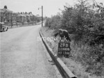 SD980029B, Man marking Ordnance Survey minor control revision point with an arrow in 1950s