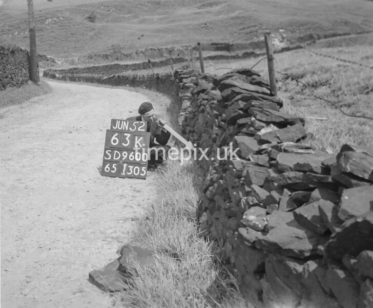 SD960063K, Man marking Ordnance Survey minor control revision point with an arrow in 1950s