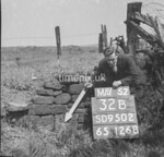 SD950232B, Man marking Ordnance Survey minor control revision point with an arrow in 1950s