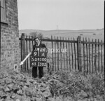 SD950091A, Man marking Ordnance Survey minor control revision point with an arrow in 1950s