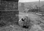 SD970285B, Man marking Ordnance Survey minor control revision point with an arrow in 1950s