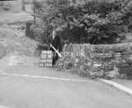 SD970132A, Man marking Ordnance Survey minor control revision point with an arrow in 1950s