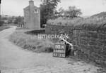 SD980180A, Man marking Ordnance Survey minor control revision point with an arrow in 1950s