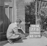 SD960277B, Man marking Ordnance Survey minor control revision point with an arrow in 1950s