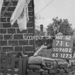 SD960271L, Man marking Ordnance Survey minor control revision point with an arrow in 1950s