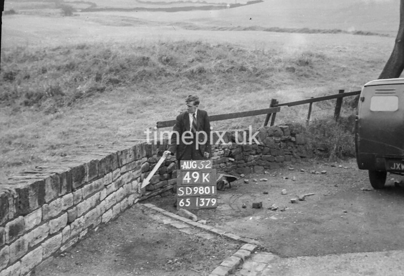 SD980149K, Man marking Ordnance Survey minor control revision point with an arrow in 1950s