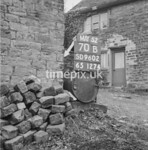 SD960270B, Man marking Ordnance Survey minor control revision point with an arrow in 1950s