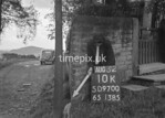 SD970010K, Man marking Ordnance Survey minor control revision point with an arrow in 1950s