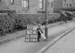 SD970282A, Man marking Ordnance Survey minor control revision point with an arrow in 1950s