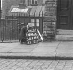 SD970149A, Man marking Ordnance Survey minor control revision point with an arrow in 1950s