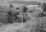 SD970019B, Man marking Ordnance Survey minor control revision point with an arrow in 1950s