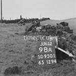SD950198A, Man marking Ordnance Survey minor control revision point with an arrow in 1950s