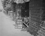 SD960288A, Man marking Ordnance Survey minor control revision point with an arrow in 1950s