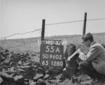 SD960255A, Man marking Ordnance Survey minor control revision point with an arrow in 1950s