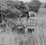 SD950165B, Man marking Ordnance Survey minor control revision point with an arrow in 1950s