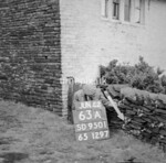 SD950163A, Man marking Ordnance Survey minor control revision point with an arrow in 1950s