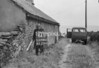 SD980264B, Man marking Ordnance Survey minor control revision point with an arrow in 1950s