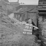 SD960270K, Man marking Ordnance Survey minor control revision point with an arrow in 1950s