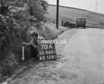 SD960170A, Man marking Ordnance Survey minor control revision point with an arrow in 1950s