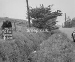 SD960008A, Man marking Ordnance Survey minor control revision point with an arrow in 1950s