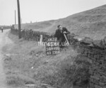 SD960063B, Man marking Ordnance Survey minor control revision point with an arrow in 1950s