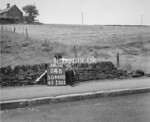 SD960014B, Man marking Ordnance Survey minor control revision point with an arrow in 1950s