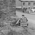 SD960027B, Man marking Ordnance Survey minor control revision point with an arrow in 1950s