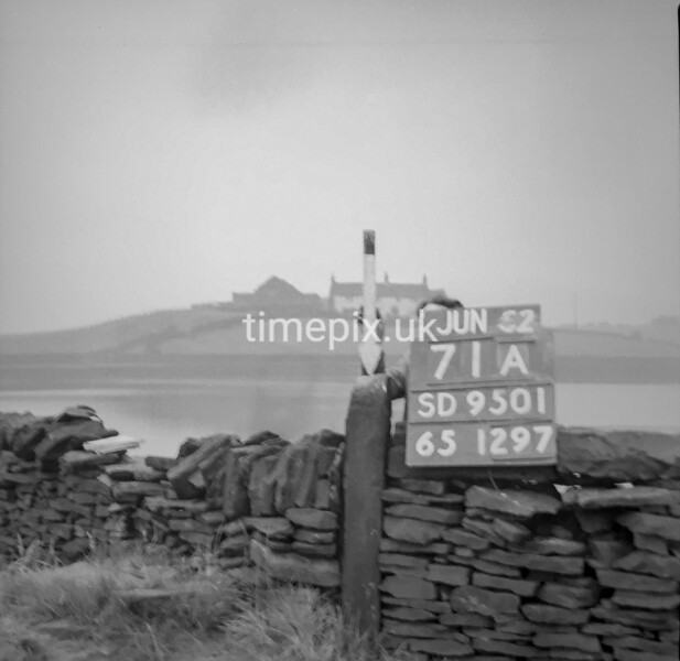 SD950171A, Man marking Ordnance Survey minor control revision point with an arrow in 1950s