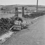 SD960048B, Man marking Ordnance Survey minor control revision point with an arrow in 1950s