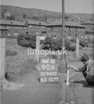 SD960290B, Man marking Ordnance Survey minor control revision point with an arrow in 1950s