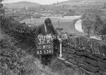 SD970132K, Man marking Ordnance Survey minor control revision point with an arrow in 1950s