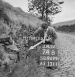 SD960074B, Man marking Ordnance Survey minor control revision point with an arrow in 1950s