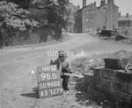 SD960296B, Man marking Ordnance Survey minor control revision point with an arrow in 1950s
