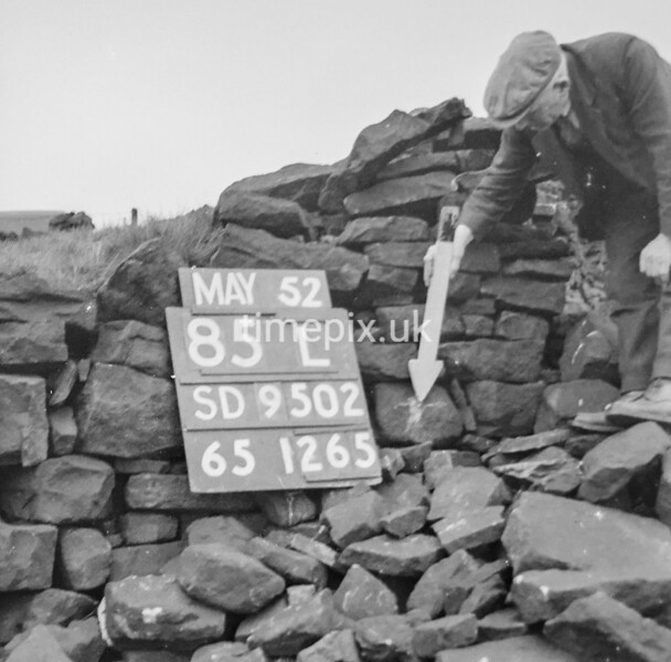 SD950285L, Man marking Ordnance Survey minor control revision point with an arrow in 1950s
