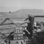 SD960235B, Man marking Ordnance Survey minor control revision point with an arrow in 1950s