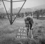 SD950192A, Man marking Ordnance Survey minor control revision point with an arrow in 1950s