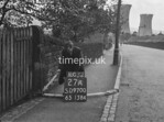 SD970027A, Man marking Ordnance Survey minor control revision point with an arrow in 1950s