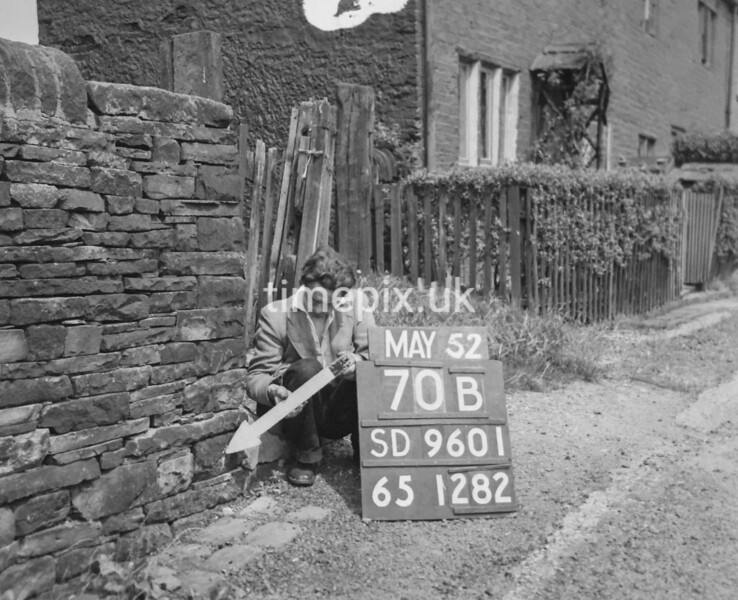 SD960170B, Man marking Ordnance Survey minor control revision point with an arrow in 1950s