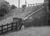 SD970151B1, Man marking Ordnance Survey minor control revision point with an arrow in 1950s