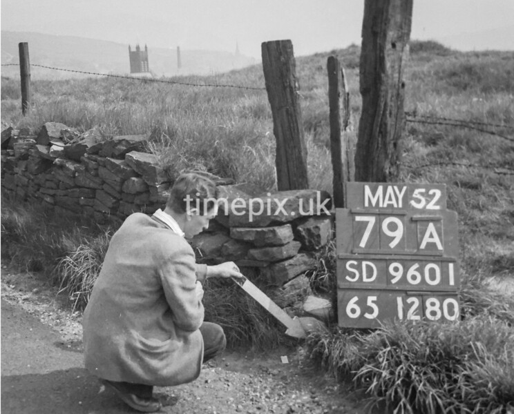 SD960179A, Man marking Ordnance Survey minor control revision point with an arrow in 1950s