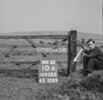 SD950210A, Man marking Ordnance Survey minor control revision point with an arrow in 1950s