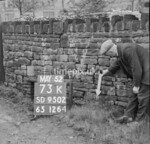 SD950273K, Man marking Ordnance Survey minor control revision point with an arrow in 1950s