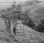 SD950148A, Man marking Ordnance Survey minor control revision point with an arrow in 1950s